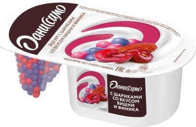 Йогурт Даниссимо Фантазия с шариками в белой шоколадной со вкусом вишни и финика 6.9% 105г